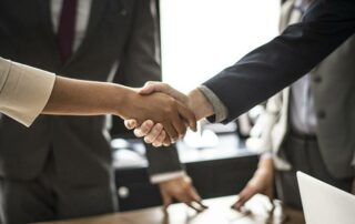 Shaking hands to seal a merger